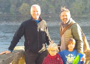 Student + teacher's family in front of river in Dordogne
