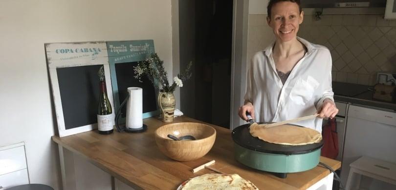 french teacher & immersion host making crêpes
