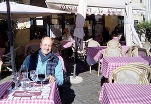 adult student sitting on sunny restaurant terrace in france French Immersion + Lesson at Teacher's Home
