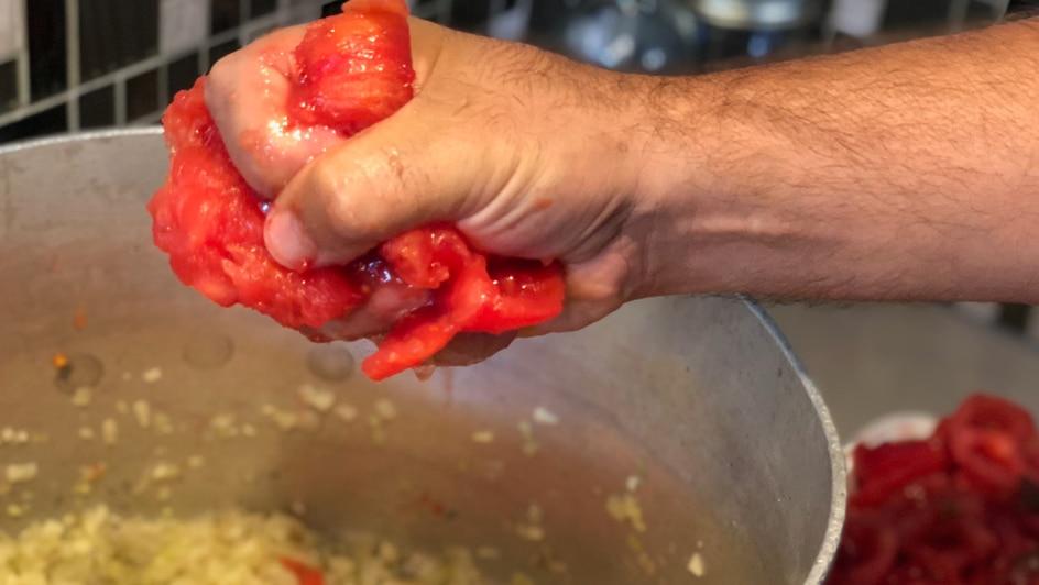 Crushing the tomatoes