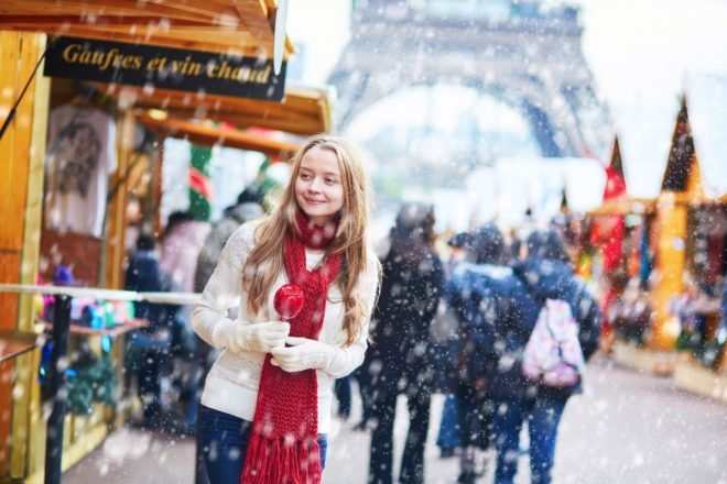 girl walking through Christmas market in Paris