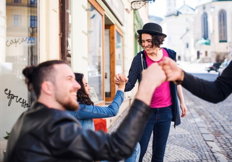 young people greeting at café paris