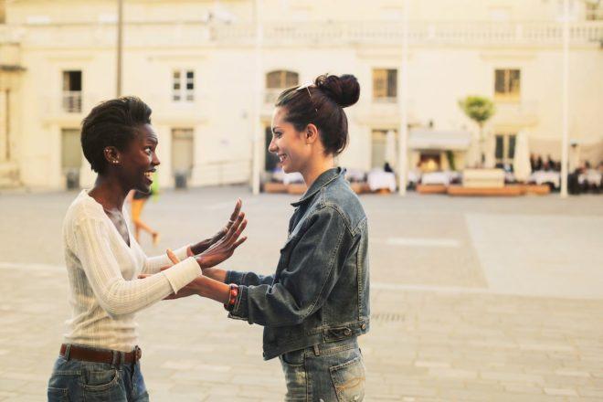 2 girls meeting in street paris