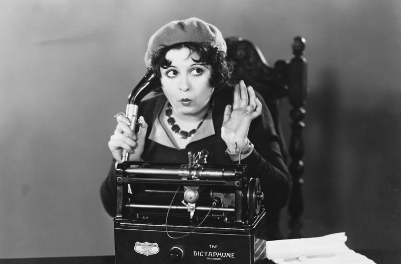 Old picture woman with beret using dictaphone